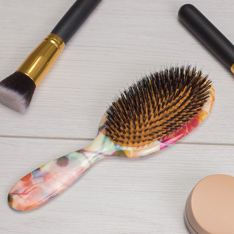 Brosse à cheveux design pour salon de beauté