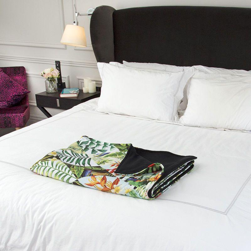 custom blankets folded on bed