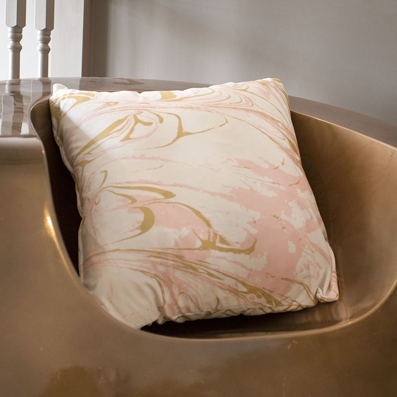 bespoke cushions on gold chair