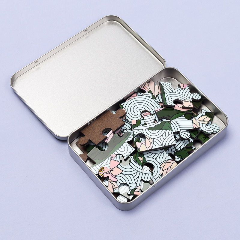 jigsaw puzzles in smart metallic tin