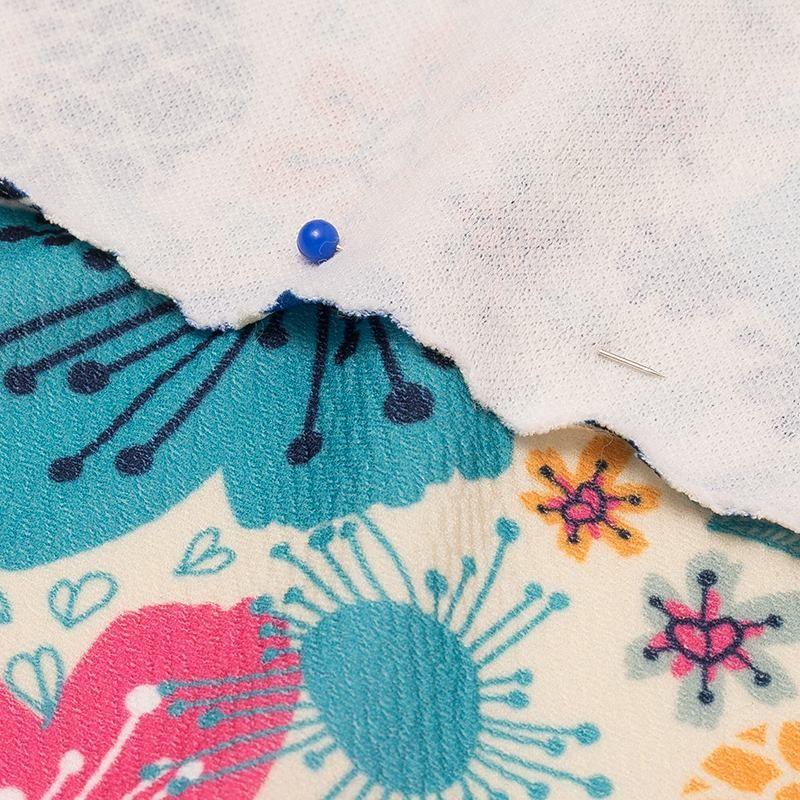 achterkant bedrukte stretch crêpe stof vastgespeld