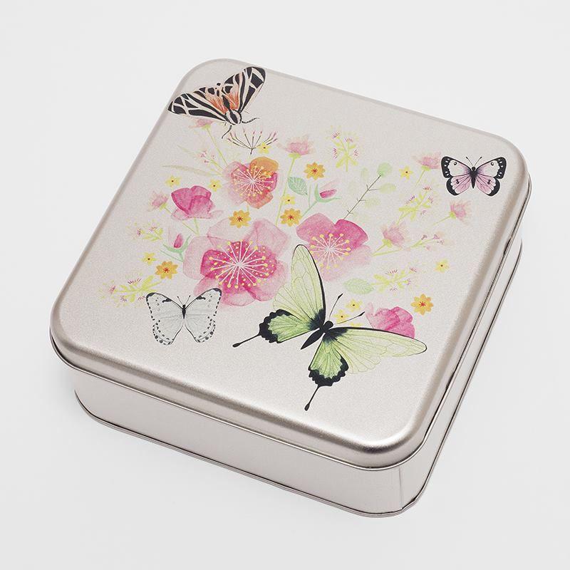 Petite boîte en métal avec dessins de papillons