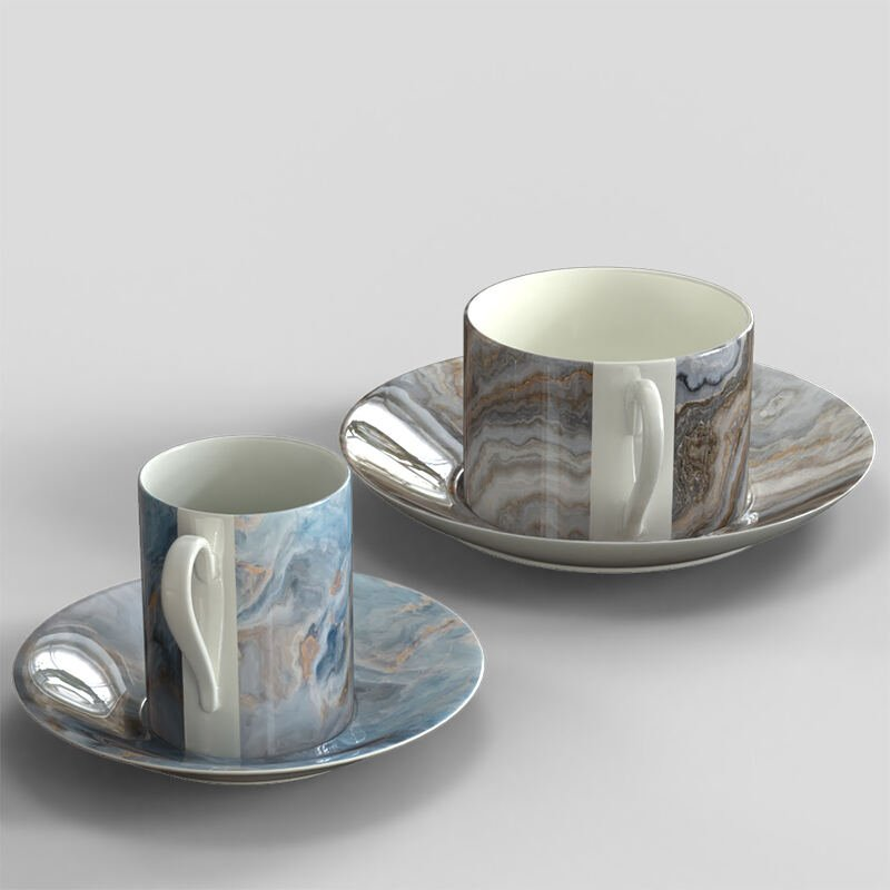egendesignade koppar med tefat