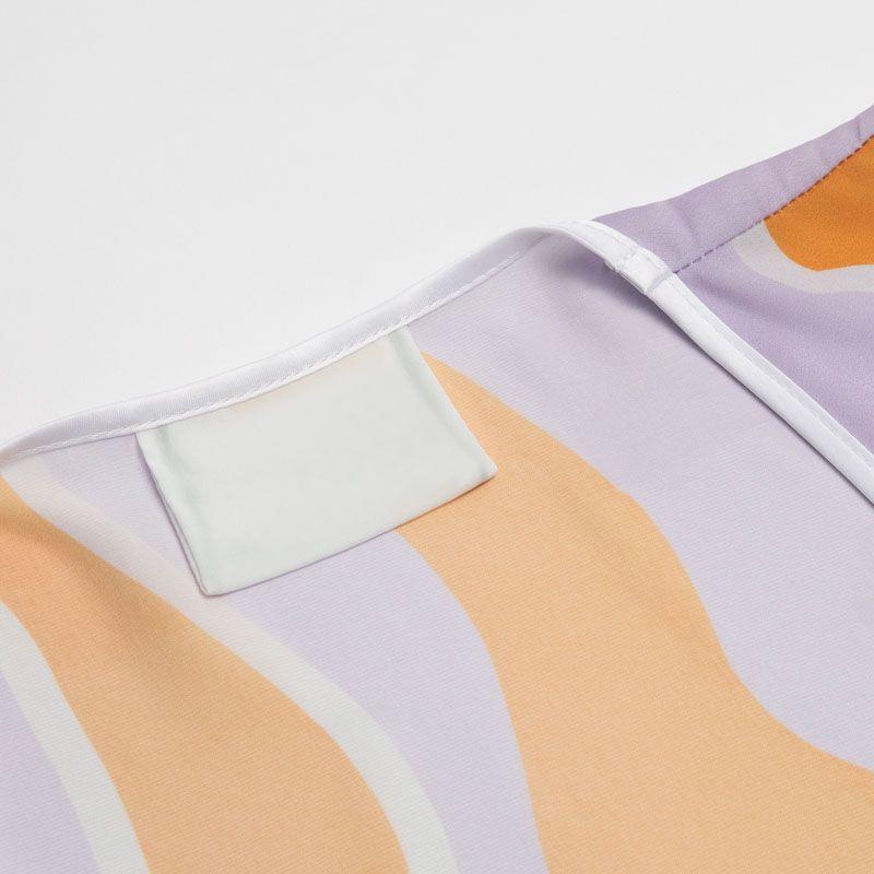 scollatura in seta su mini abito portafoglio personalizzato