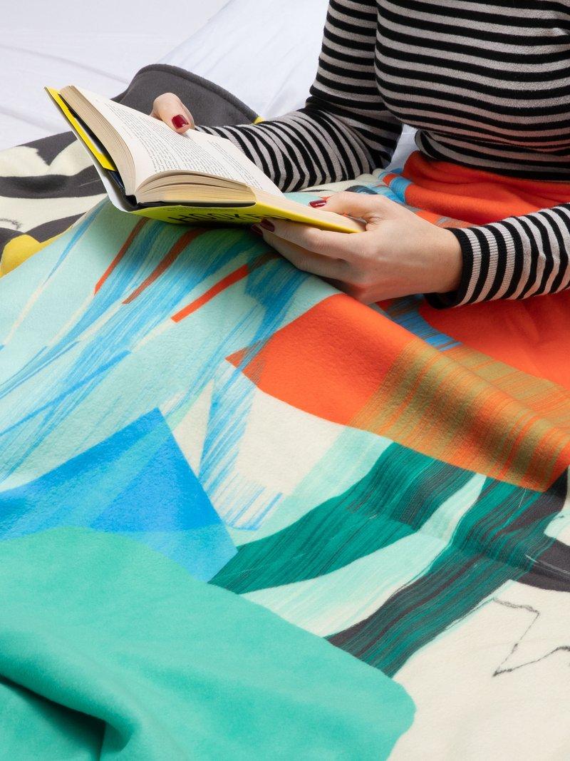 gepersonaliseerde dekens opgerold