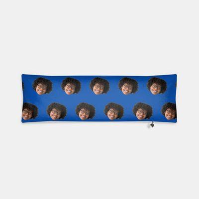 cylinderkudde med ansikten