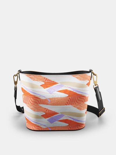 Egendesignad bucketväska i läder